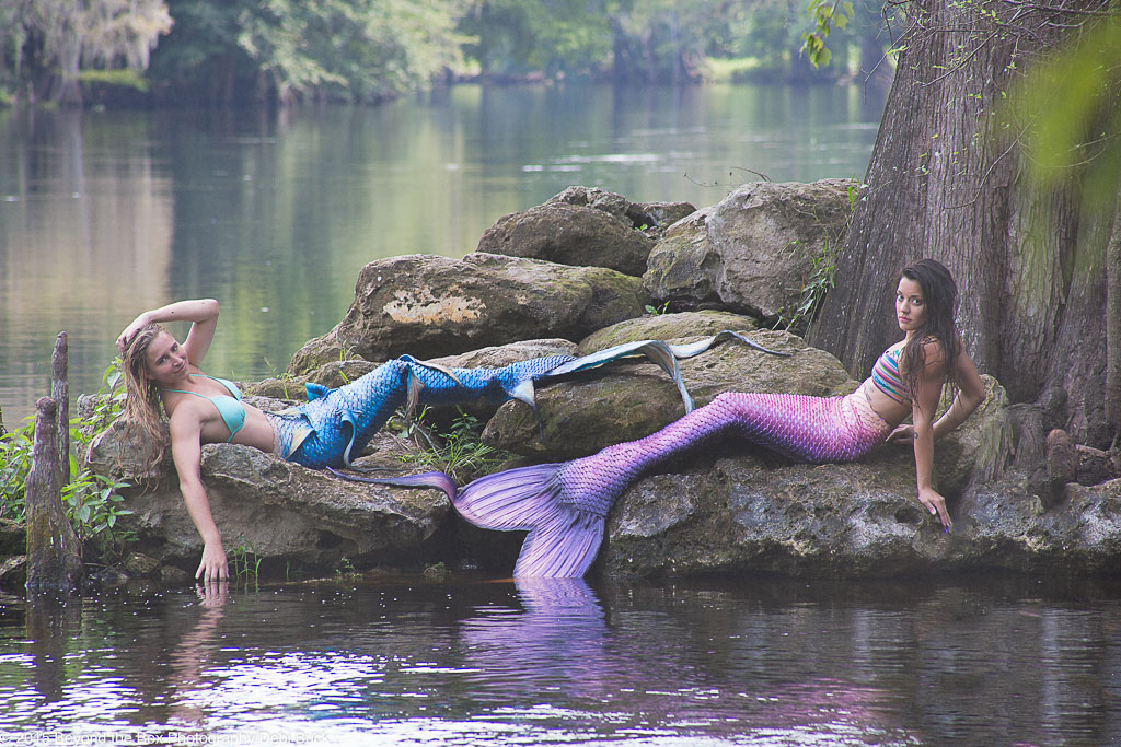 Hawaii Conceptual Portrait two mermaids laying beside water