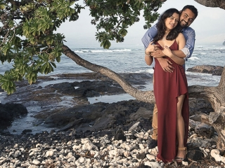 Hawaii Portrait couple photography embracing near tree and ocean mauna lani resort kona
