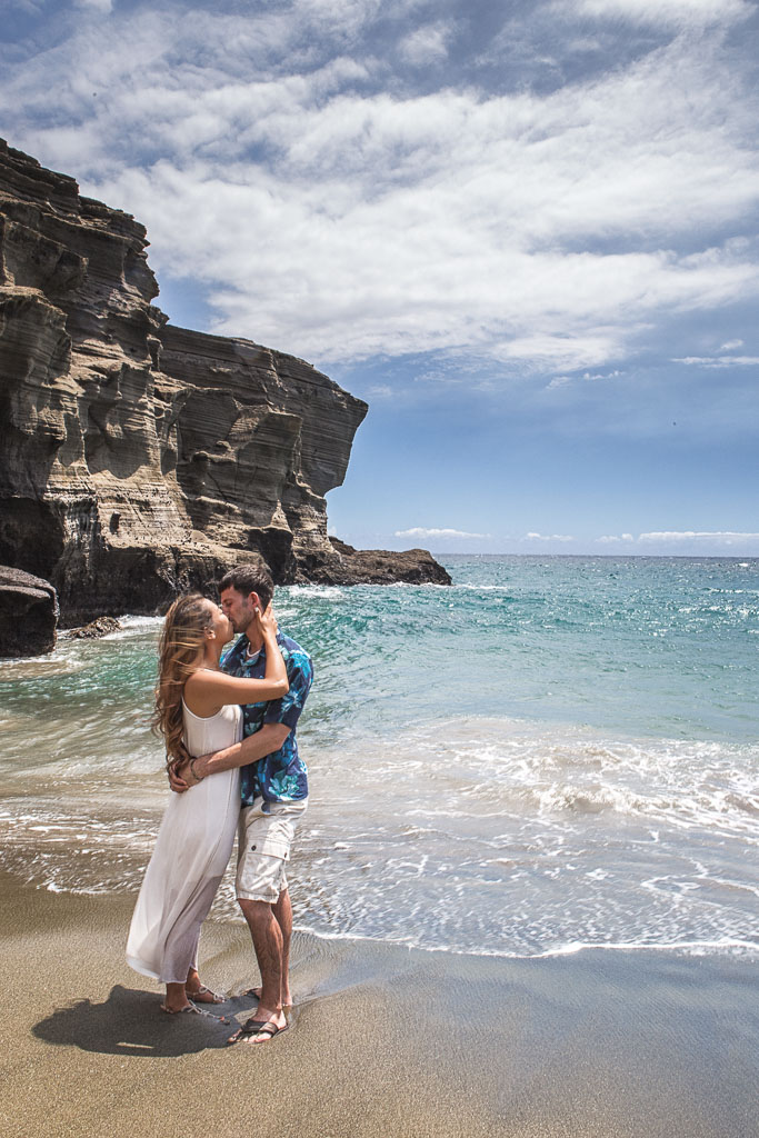 Hawaii Portrait engagement photography green sand beach couple kissing professional photographer