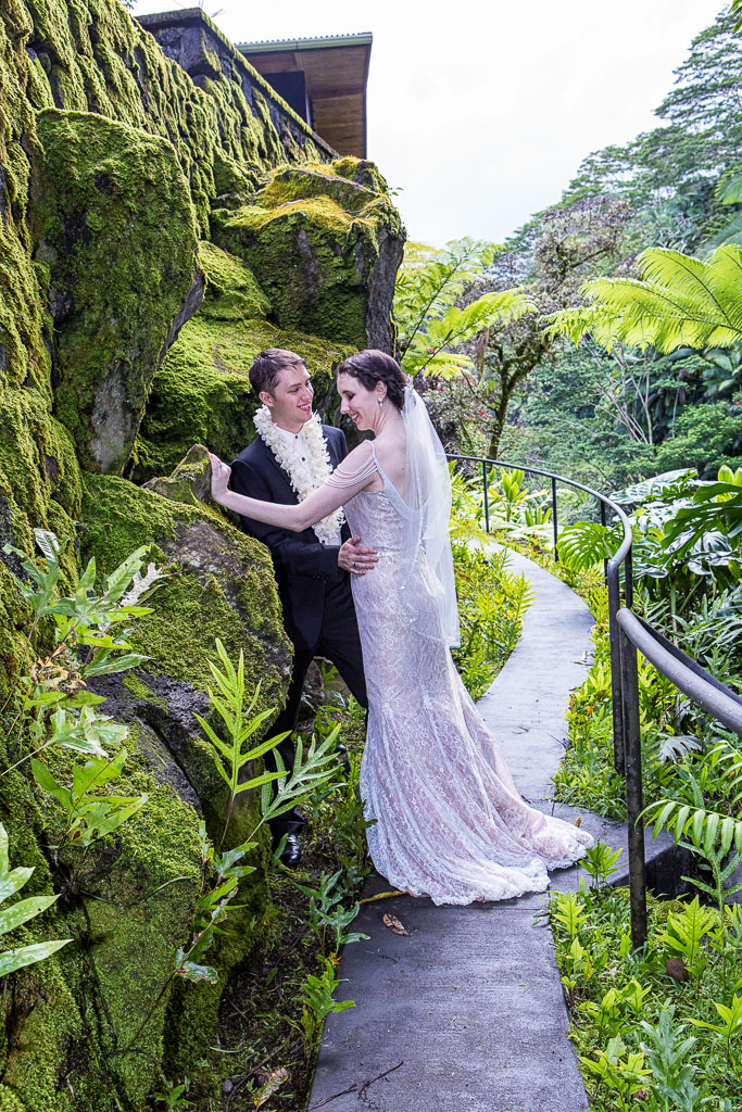 Hawaii wedding  professional photographer the falls at reeds island rock wall and path bride and groom formal