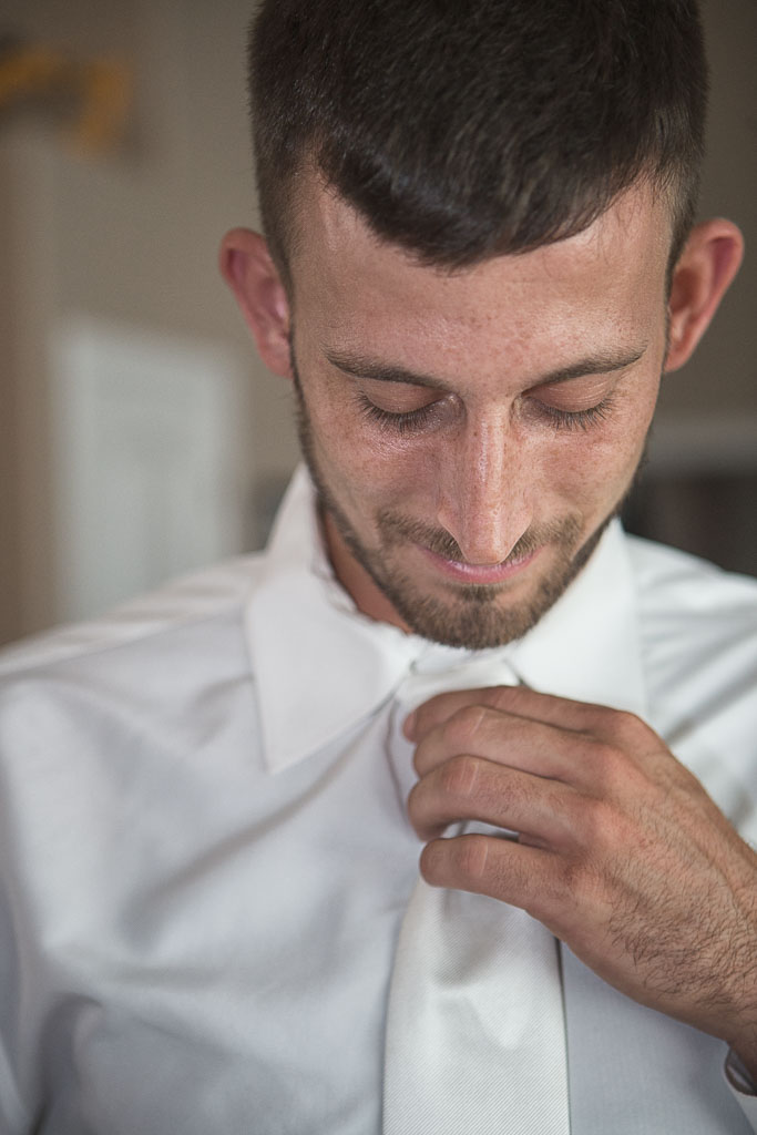 Hawaii wedding groom getting ready adjusting tie Hilo professional photographer
