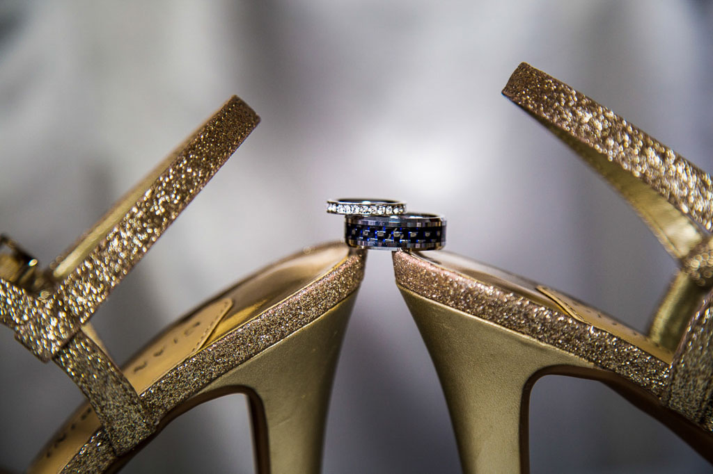 Hawaii wedding professional photographer wedding rings on bride shoes