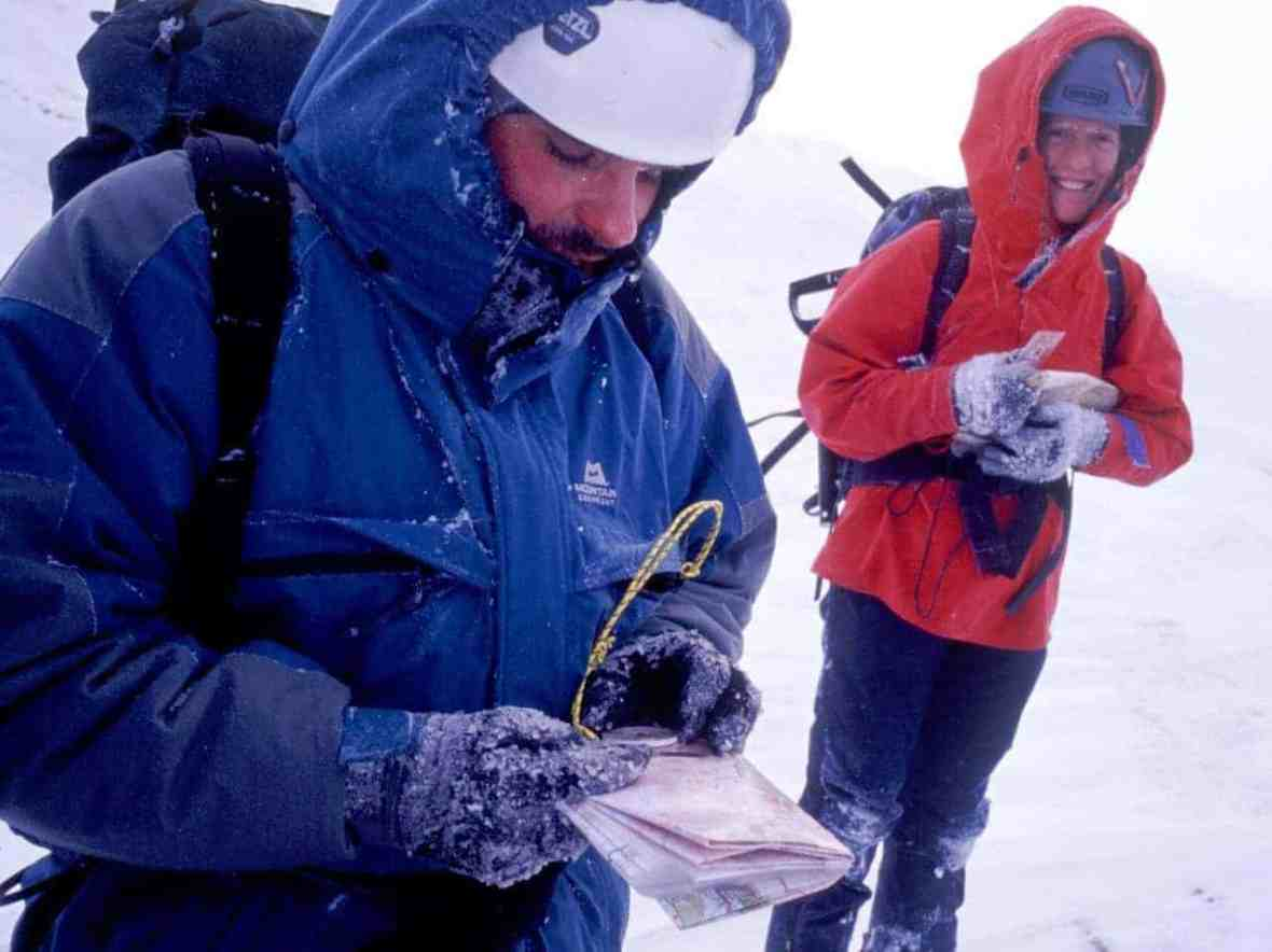 Two people practicing navigating in winter