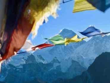 Prayer flags fluttering in front of Everest. Trek from Everest base camp.