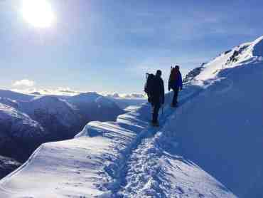 A winter skills course traverses a ridge in Scotland