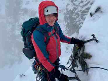 A lady climbing snow and ice in Scotland