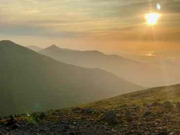 Sunset view of Snowdonia from Carnedd Dafydd on a Guided hillwalking course in Snowdonia.
