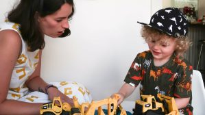 Speech therapy playing with trucks