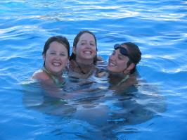 Having fun in the pool with my sisters