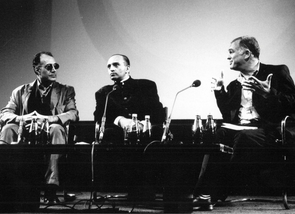 Abbas Kiarostami (left) interviewed by Geoff Andrew (right) with an interpreter at the National Film Theatre (now BFI Southbank) in 1999