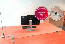 Photo of Free-standing COVID-19 Easy Sneeze Guard office desk solution from Glassolutions