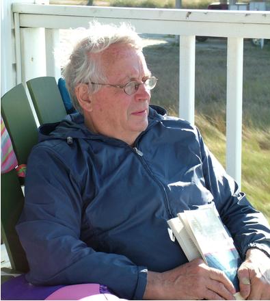 an elderly man sitting on the porch