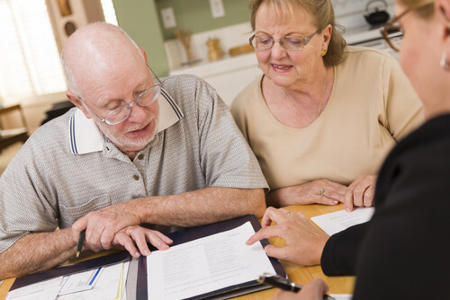 seniors with insurance agent