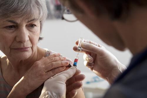 elderly person receiving vaccine