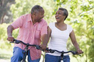 senior couple exercising on bikes