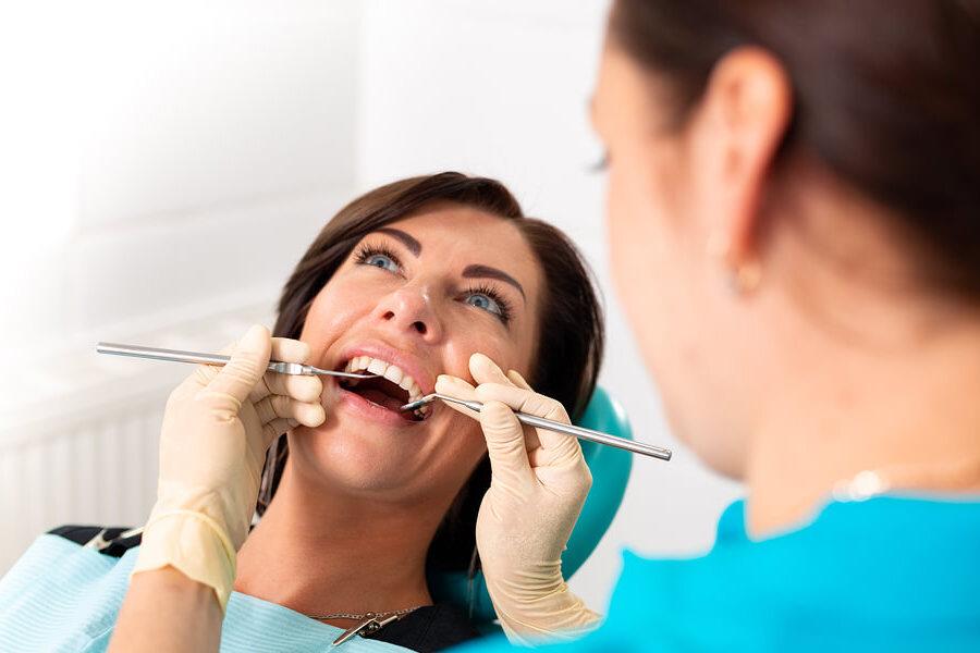 dentist inspecting braces