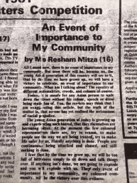 "[Image Description: A photo of a black-and-white newspaper article titled ""An Event of Importance to My Community"" by Ms Resham Mitza (16)"""