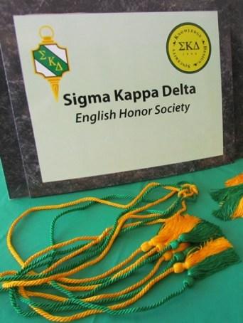 Sigma Kappa Delta with tassels