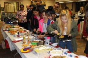 Students sampling food at the international food competition