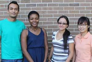 International Students smiling in front of campus