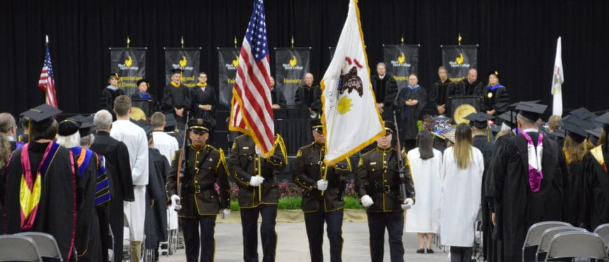 Veterans marching at commencement