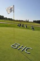 BHC spelled in golf balls on the green