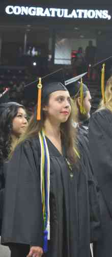 female grad wearing honors cords
