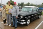 Becky Wynes & Black Hawk College President Tim Wynes presenting President's Choice Award to Gary Crowe in front of his 1954 Ford