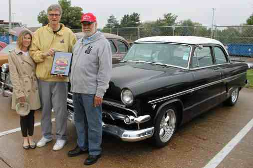 Becky Wynes & BHC President Tim Wynes presenting President's Choice Award to Gary Crowe in front of his 1954 Ford