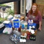 female student with donations for nursing home