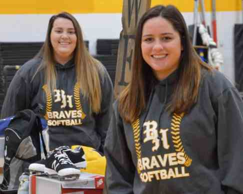 2 women wearing BHC Braves softball sweatshirts