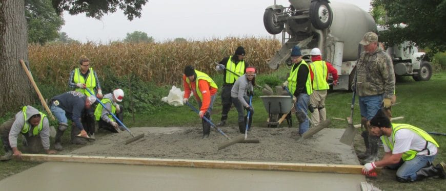 Students practice pouring concrete