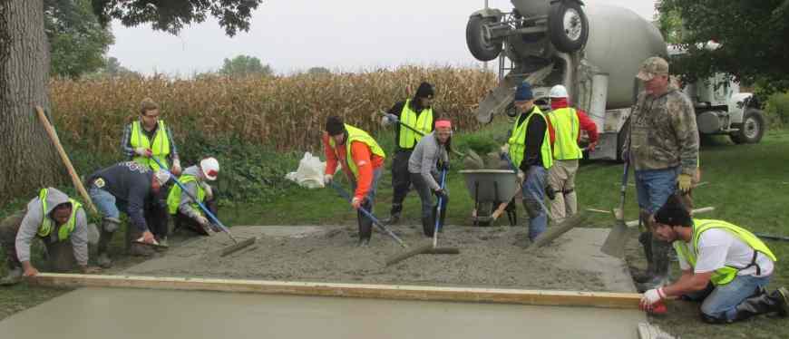 Students practice pouring concrete