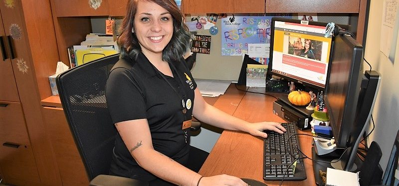 BHC career navigator Megan Hasselroth sits at her computer desk