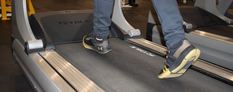 close up of person jogging on a treadmill's feet