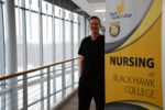 student posing near nursing sign
