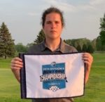golfer Rielly McGranahan holding small tournament banner
