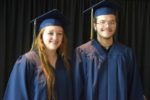 2 grads in blue caps & gowns