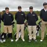 5 golfers standing & smiling at camera