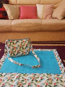 Firoza blue ladies quilted masalla bag