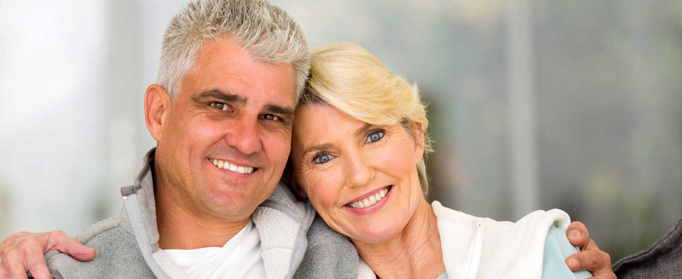 Happy couple after dental restoration