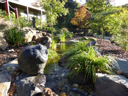 Natural pondless stream in Japanese garden.