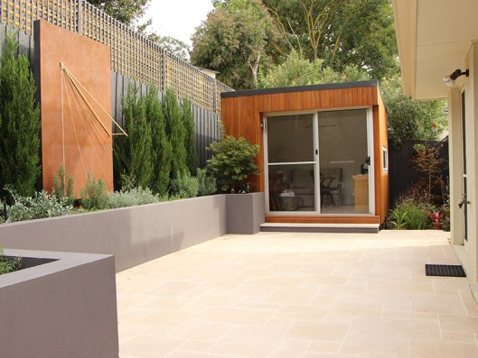 Limestone-paved courtyard with outdoor office in Mitcham.