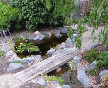 Stream leading into a garden pond