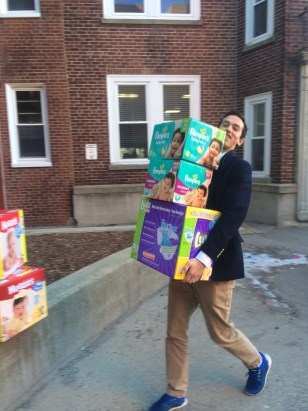 Charlie Danziger '16 carries diapers to be delivered
