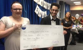 Rohan and Chloe with the winners cheque