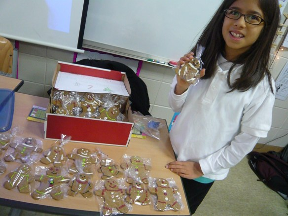 Olivia selling her homemade gingerbread cookies at her class market day.