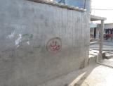Arabic Nun symbol painted on Christian business