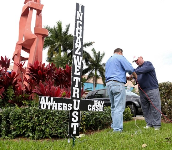 Chaz Stevens plants black upside-down cross on lawn of City Hall in Florida