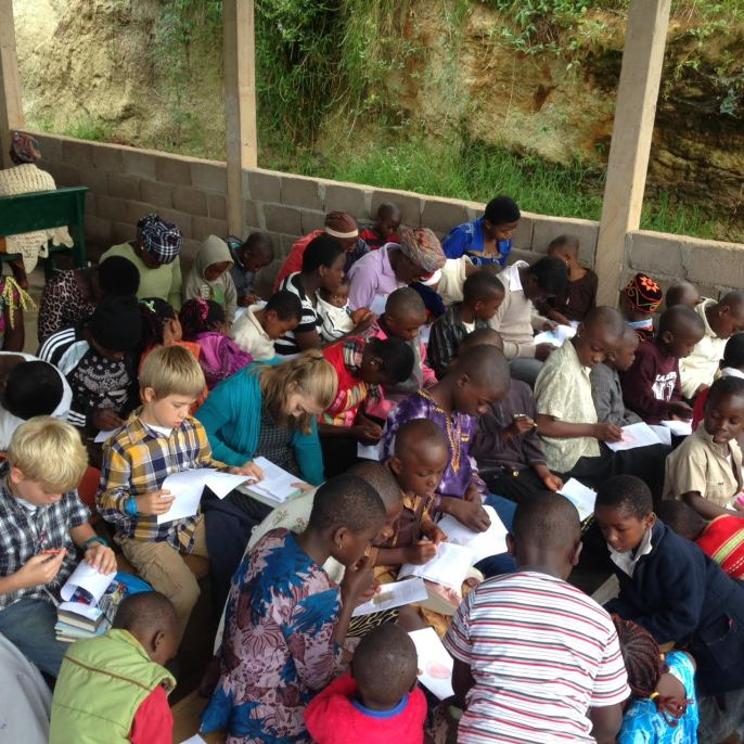 A Group of Children Coloring Bible StoryBoards in Cameroon